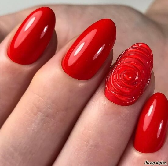 3D дизайн на красных круглых ногтях